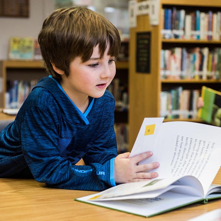 Langley student boy reading