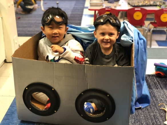 Purposeful Play - boys playing in a cardboard
